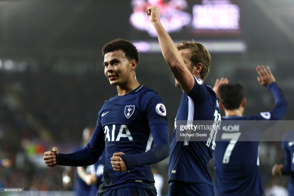 Dele Alli of Tottenham Hotspur celebrates after scoring his sides second goal with Harry Kane of Tottenham Hotspur during the Premier League match between Swansea City and Tottenham Hotspur at Liberty Stadium on January 2, 2018 in Swansea, Wales.