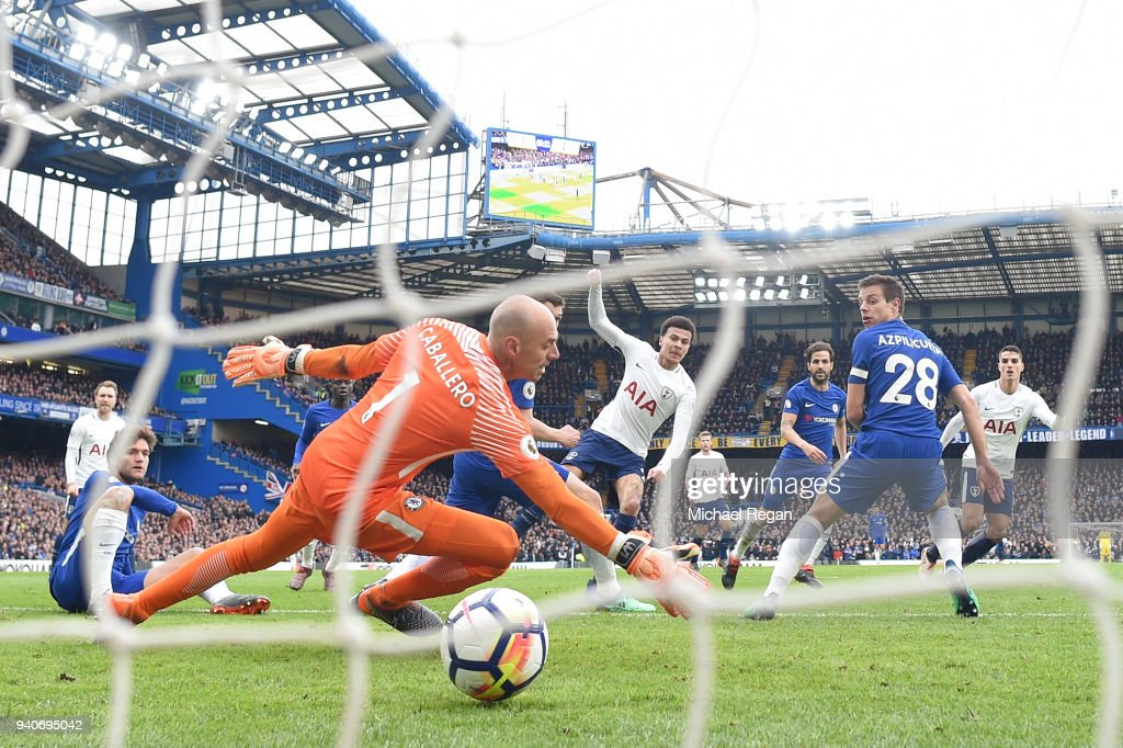 Dele Alli of Tottenham Hotspur celebrates after scoring his sides third goal past Willy Caballero of Chelsea during the Premier League match between Chelsea and Tottenham Hotspur at Stamford Bridge on April 1, 2018 in London, England.