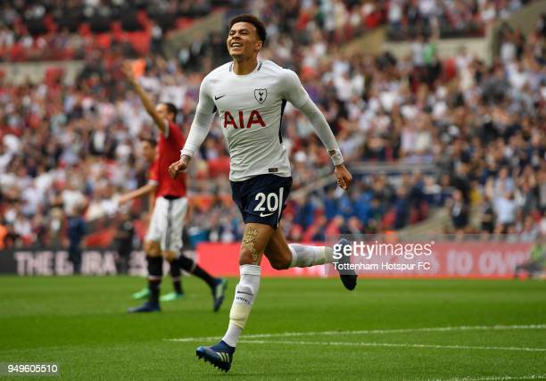 Dele Alli of Tottenham Hotspur celebrates after scoring his sides first goal during The Emirates FA Cup Semi Final match between Manchester United...