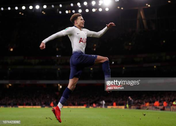 Dele Alli of Tottenham Hotspur celebrates after scoring his team's second goal during the Carabao Cup Quarter Final match between Arsenal and...