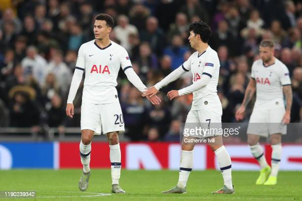 Dele Alli of Tottenham Hotspur celebrates after scoring his team's first goal with teammate Heung-Min Son during the UEFA Champions League group B...