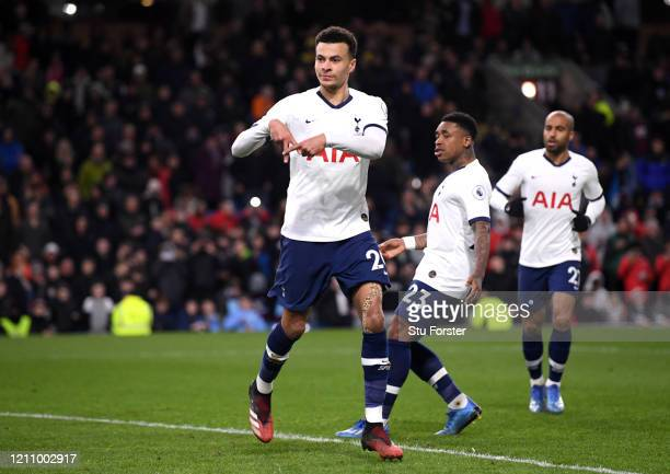 Dele Alli of Tottenham Hotspur celebrates after scoring his team's first goal from the penalty spot during the Premier League match between Burnley...