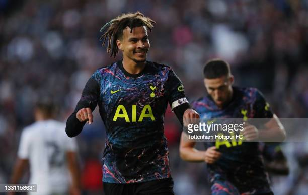 Dele Alli of Tottenham Hotspur celebrates after scoring their second goal during the Pre-Season Friendly match between Milton Keynes Dons and...