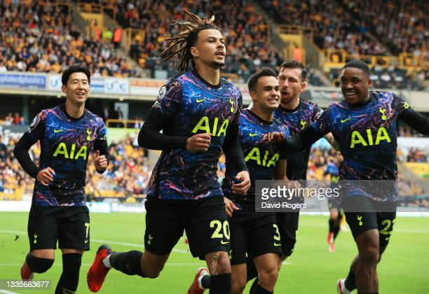 Dele Alli of Tottenham Hotspur celebrates after scoring their side's first goal from the penalty spot during the Premier League match between...