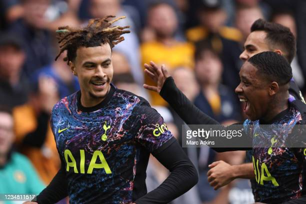 Dele Alli of Tottenham Hotspur celebrates scoring his goal with Steven Bergwijn during the Premier League match between Wolverhampton Wanderers and...