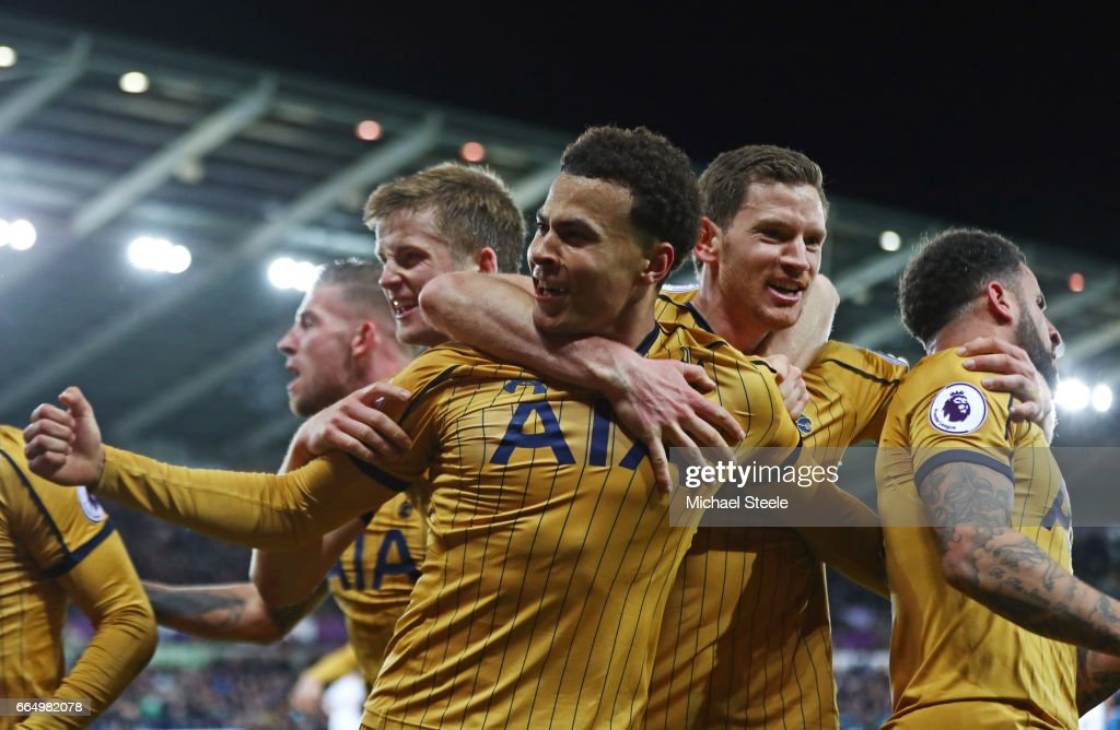 Dele Alli of Tottenham Hotspur celebrates scoring his sides first goal with his Tottenham Hotspur team mates during the Premier League match between Swansea City and Tottenham Hotspur at the Liberty Stadium on April 5, 2017 in Swansea, Wales.