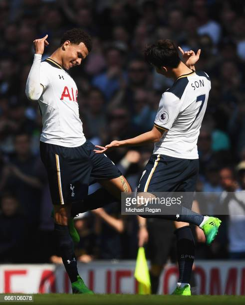 Dele Alli of Tottenham Hotspur celebrates scoring his sides first goal with HeungMin Son of Tottenham Hotspur during the Premier League match between...