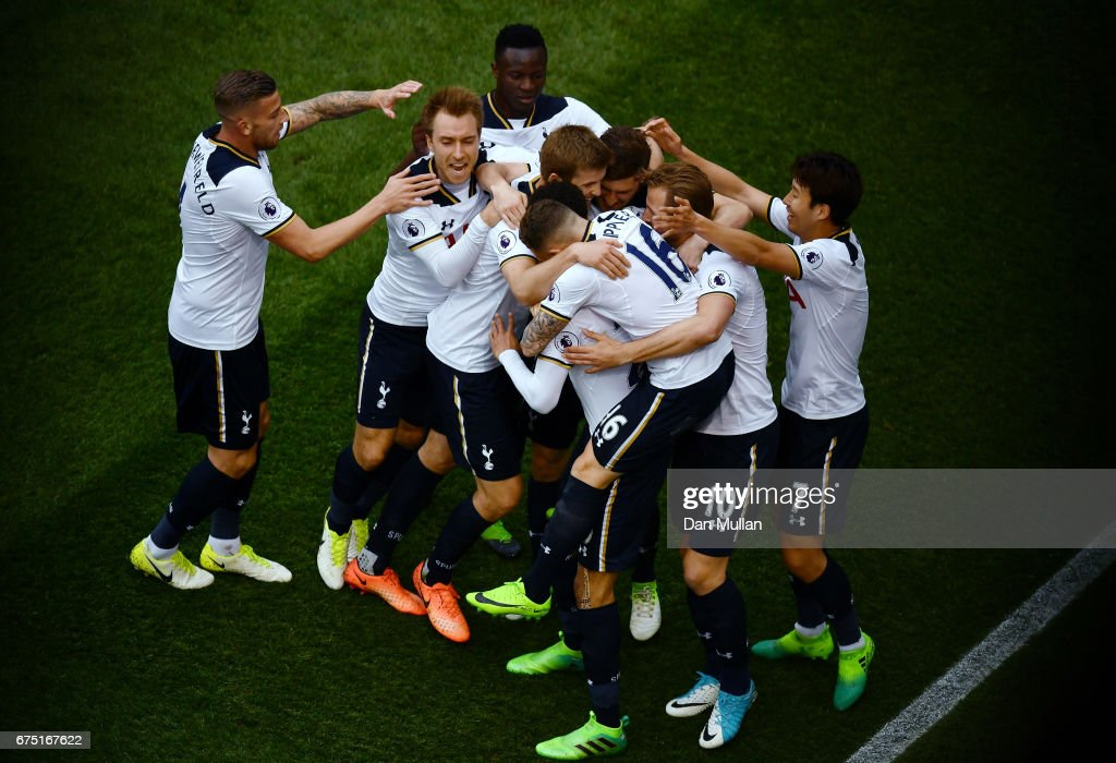 Dele Alli of Tottenham Hotspur celebrates scoring his sides first goal with his Tottenham Hotspur team mates during the Premier League match between Tottenham Hotspur and Arsenal at White Hart Lane on April 30, 2017 in London, England.