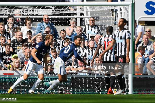 Dele Alli of Tottenham Hotspur celebrates scoring his sides first goal during the Premier League match between Newcastle United and Tottenham Hotspur...
