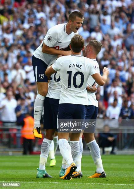 Dele Alli of Tottenham Hotspur celebrates scoring his sides first goal with his Tottenham Hotspur team mates during the Premier League match between...