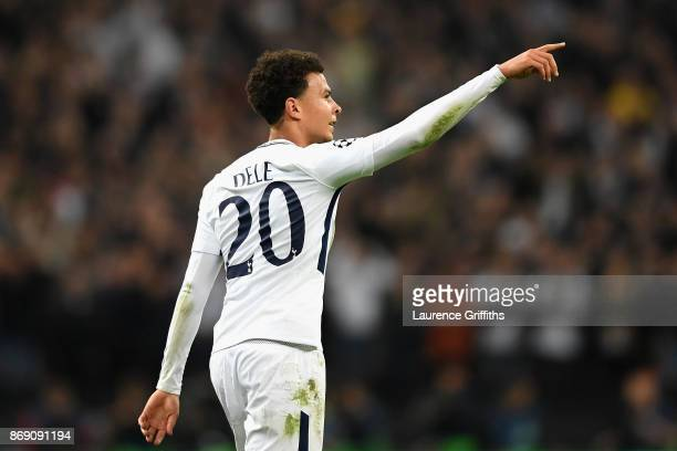 Dele Alli of Tottenham Hotspur celebrates scoring his side's first goal during the UEFA Champions League group H match between Tottenham Hotspur and...