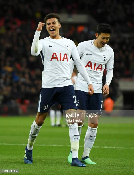 Dele Alli of Tottenham Hotspur celebrates scoring his side's first goal with team mate HeungMin Son during the Premier League match between Tottenham...