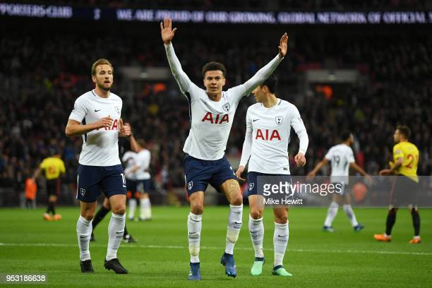 Dele Alli of Tottenham Hotspur celebrates scoring his side's first goal with team mates Harry Kane and HeungMin Son during the Premier League match...