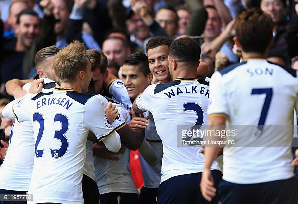 Dele Alli of Tottenham Hotspur celebrates scoring his sides second goal with his team mates during the Premier League match between Tottenham Hotspur...