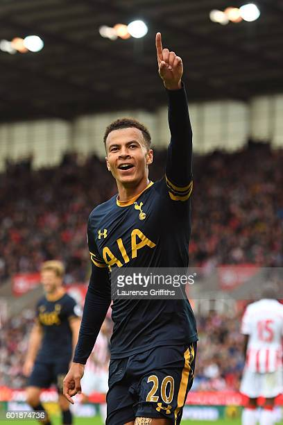 Dele Alli of Tottenham Hotspur celebrates scoring his sides third goal during the Premier League match between Stoke City and Tottenham Hotspur at...