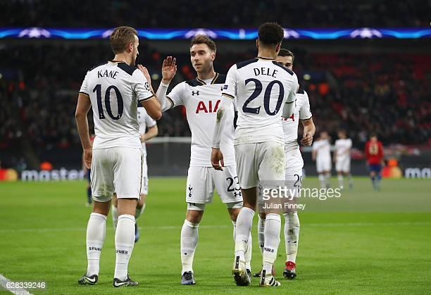 Dele Alli of Tottenham Hotspur celebrates scoring his sides third goal with his Tottenham Hotspur team mates during the UEFA Champions League Group E...