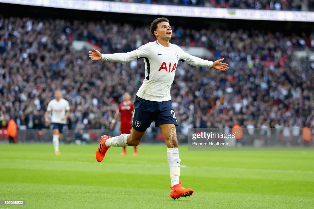 Dele Alli of Tottenham Hotspur celebrates scoring his sides third goal during the Premier League match between Tottenham Hotspur and Liverpool at Wembley Stadium on October 22, 2017 in London, England.