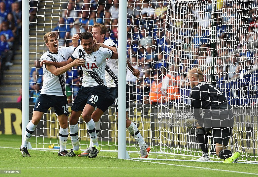 Dele Alli (2nd L) of Tottenham Hotspur celebrates scoring his team's first goal with his team mates Tom Carroll (1st L) and Harry Kane (3rd L) during the Barclays Premier League match between Leicester City and Tottenham Hotspur at The King Power Stadium on August 22, 2015 in Leicester, England.