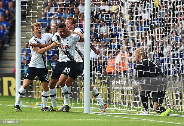 Dele Alli of Tottenham Hotspur celebrates scoring his team's first goal with his team mates Tom Carroll and Harry Kane during the Barclays Premier...