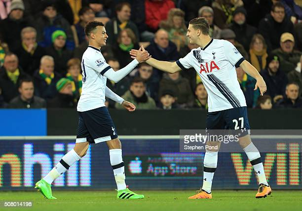 Dele Alli of Tottenham Hotspur celebrates scoring his team's first goal with his team mate Kevin Wimmer during the Barclays Premier League match...