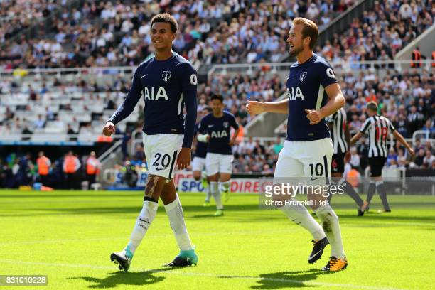Dele Alli of Tottenham Hotspur celebrates scoring his team's first goal with teammate Harry Kane during the Premier League match between Newcastle...