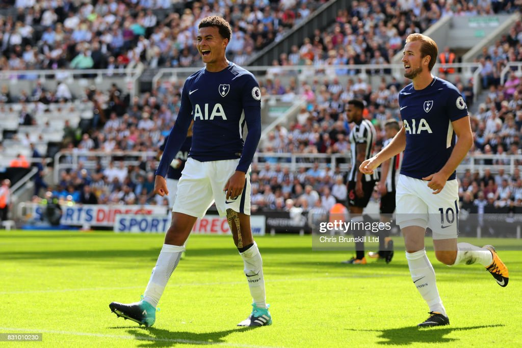 Dele Alli of Tottenham Hotspur celebrates scoring his team's first goal with team-mate Harry Kane (R) during the Premier League match between Newcastle United and Tottenham Hotspur at St. James' Park on August 13, 2017 in Newcastle upon Tyne, England.