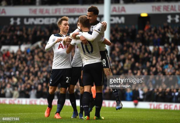 Dele Alli of Tottenham Hotspur celebrates scoring his teams fourth goal with teammates Harry Kane and Christian Eriksen during the Premier League...