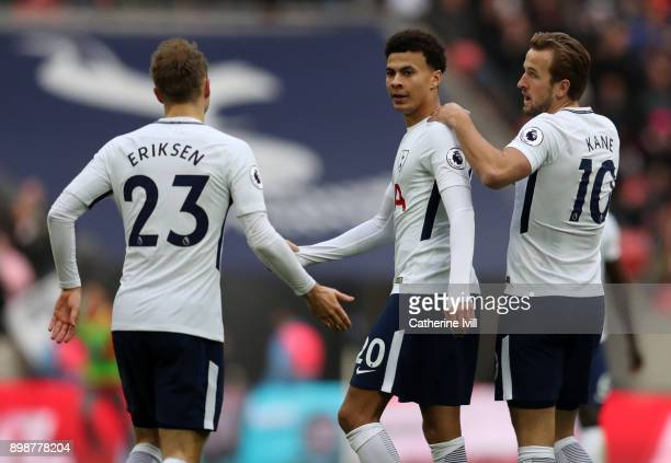 Dele Alli of Tottenham Hotspur celebrates with Harry Kane and Christian Eriksen of Tottenham Hotspur during the Premier League match between...