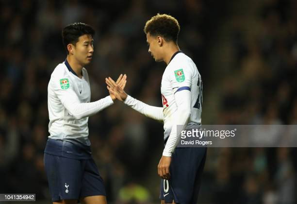 Dele Alli of Tottenham Hotspur celebrates with team mate HeungMin Son after scoring their first goal during the Carabao Cup Third Round match between...