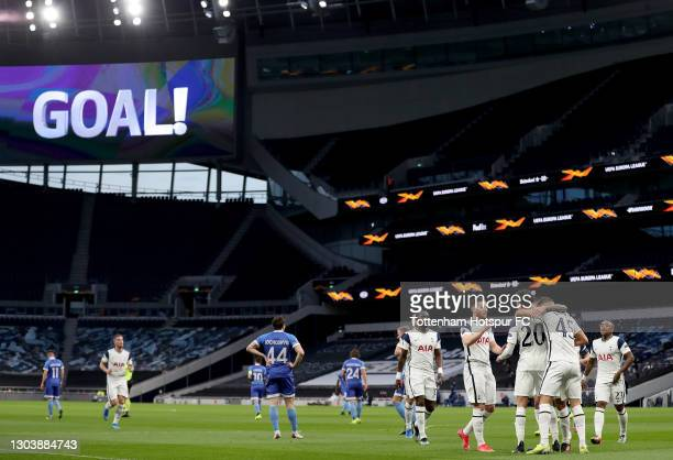 Dele Alli of Tottenham Hotspur celebrates with team mates after scoring their team's first goal during the UEFA Europa League Round of 32 match...