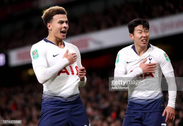 Dele Alli of Tottenham Hotspur celebrates with teammate HeungMin Son after scoring his team's second goal during the Carabao Cup Quarter Final match...