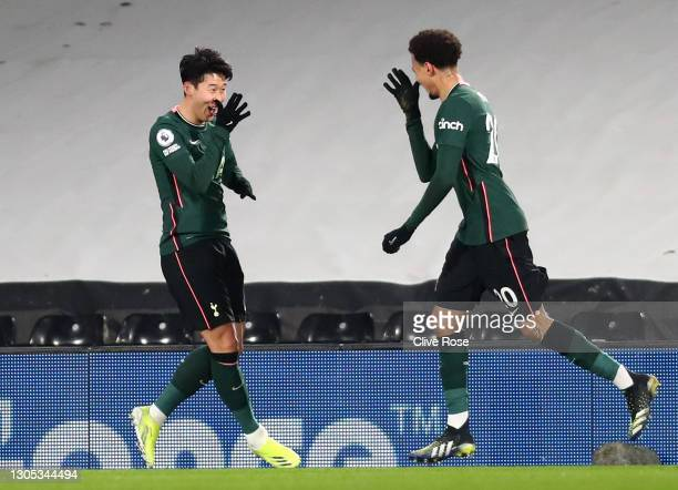 Dele Alli of Tottenham Hotspur celebrates with teammate Son Heung-Min after scoring his team's first goal during the Premier League match between...