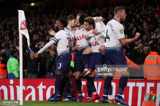 Dele Alli of Tottenham Hotspur celebrates with teammates after scoring his team's second goal during the Carabao Cup Quarter Final match between...