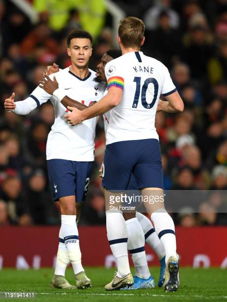Dele Alli of Tottenham Hotspur celebrates with teammates after scoring his team's first goal during the Premier League match between Manchester...