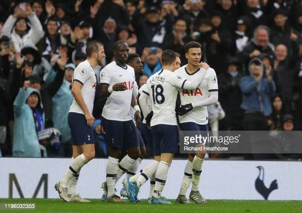 Dele Alli of Tottenham Hotspur celebrates with teammates after scoring his teams second goal during the Premier League match between Tottenham...