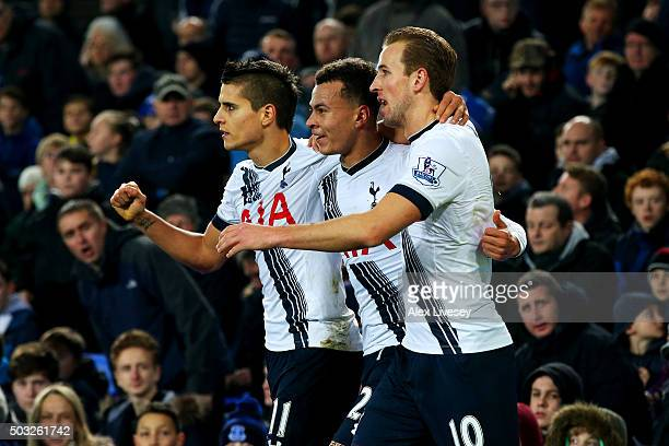 Dele Alli of Tottenham Hotspur celebrates with teammates Erik Lamela and Harry Kane after scoring his team's first goal during the Barclays Premier...