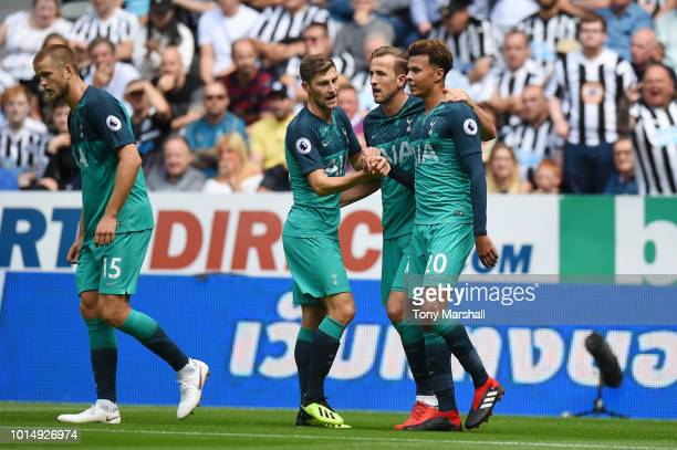 Dele Alli of Tottenham Hotspur celebrates with teammates Harry Kane and Ben Davies after scoring his team's second goal during the Premier League...