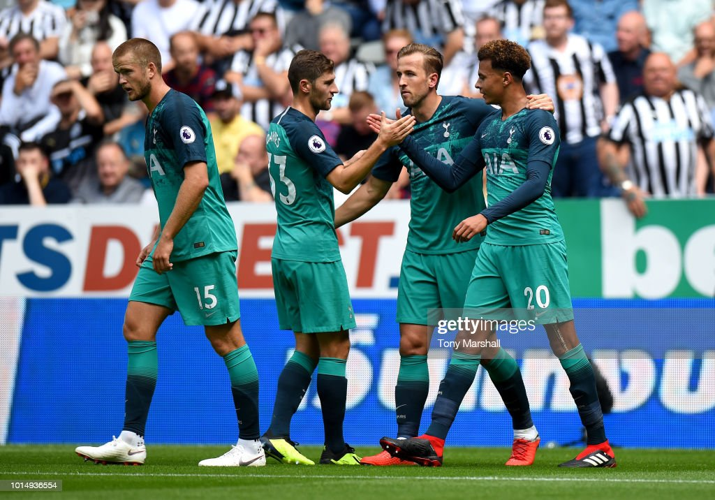 Dele Alli of Tottenham Hotspur celebrates with teammates Harry Kane and Ben Davies after scoring his team's second goal during the Premier League match between Newcastle United and Tottenham Hotspur at St. James Park on August 11, 2018 in Newcastle upon Tyne, United Kingdom.