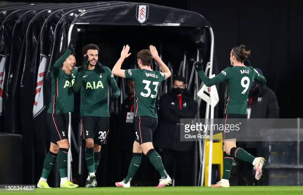 Dele Alli of Tottenham Hotspur celebrates with teammates Son Heung-Min, Ben Davies, and Gareth Bale after scoring his team's first goal during the...