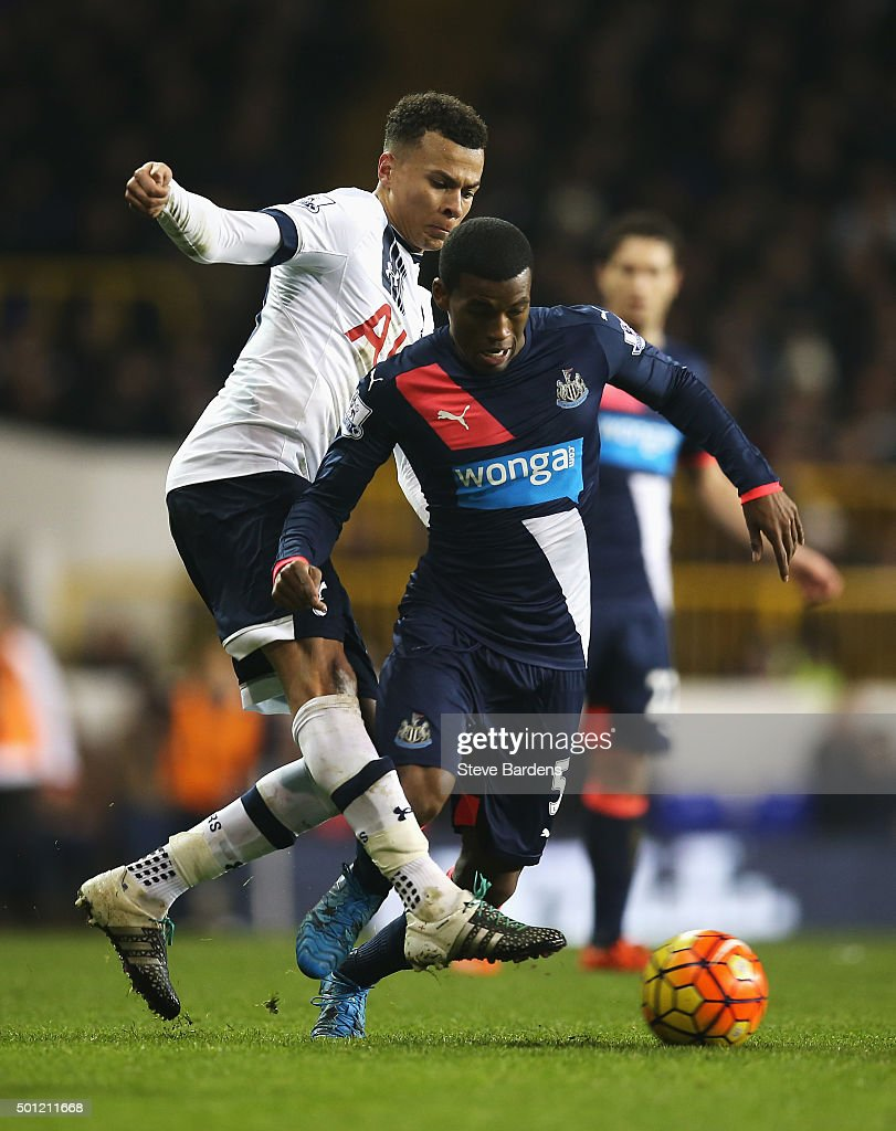 Dele Alli of Tottenham Hotspur challenges Georginio Wijnaldum of Newcastle United during the Barclays Premier League match between Tottenham Hotspur and Newcastle United at White Hart Lane on December 13, 2015 in London, England.