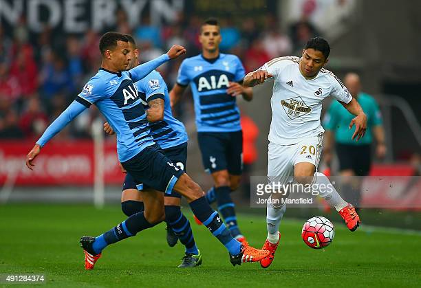Dele Alli of Tottenham Hotspur challenges Jefferson Montero of Swansea City during the Barclays Premier League match between Swansea City and...