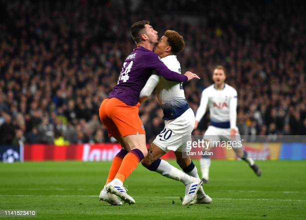 Dele Alli of Tottenham Hotspur colides with Aymeric Laporte of Manchester City during the UEFA Champions League Quarter Final first leg match between...