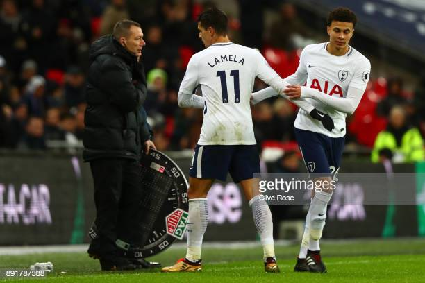Dele Alli of Tottenham Hotspur comes on for Erik Lamela of Tottenham Hotspur during the Premier League match between Tottenham Hotspur and Brighton...