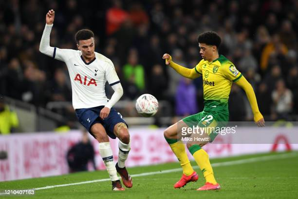 Dele Alli of Tottenham Hotspur compete for the ball with Jamal Lewis of Norwich City during the FA Cup Fifth Round match between Tottenham Hotspur...