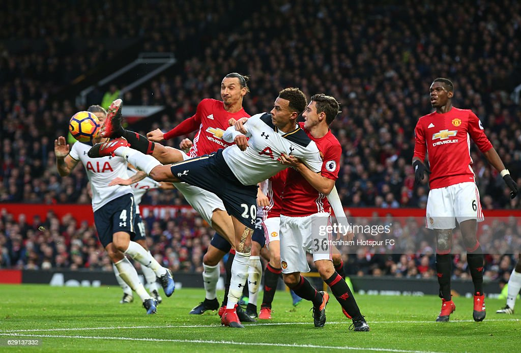 Dele Alli of Tottenham Hotspur competes for the ball against m36a and Zlatan Ibrahimovic of Manchester United during the Premier League match between Manchester United and Tottenham Hotspur at Old Trafford on December 11, 2016 in Manchester, England.