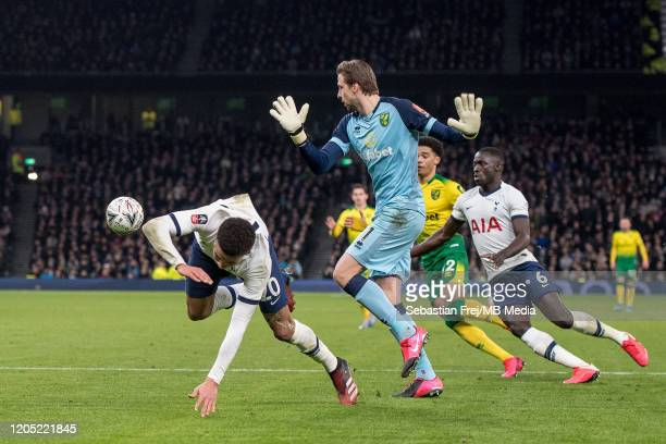 Dele Alli of Tottenham Hotspur competes for the ball with Tim Krul of Norwich City during the FA Cup Fifth Round match between Tottenham Hotspur and...