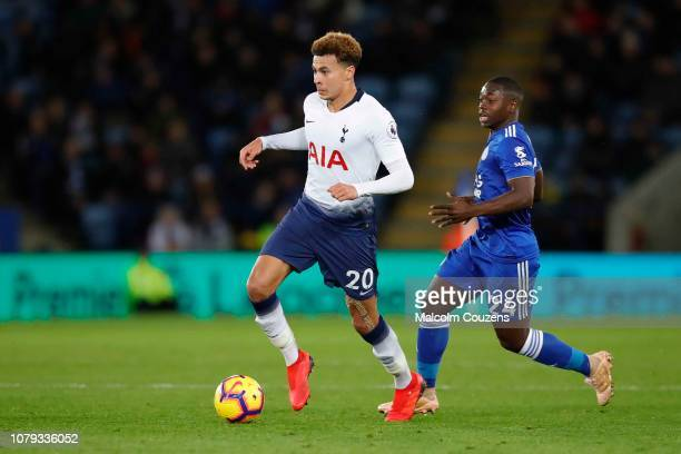Dele Alli of Tottenham Hotspur competes with Nampalys Mendy of Leicester City during the Premier League match between Leicester City and Tottenham...