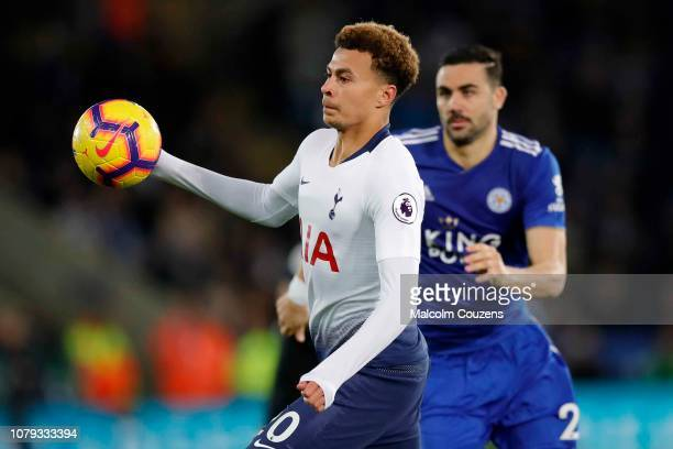 Dele Alli of Tottenham Hotspur competes with Vicente Iborra of Leicester City during the Premier League match between Leicester City and Tottenham...
