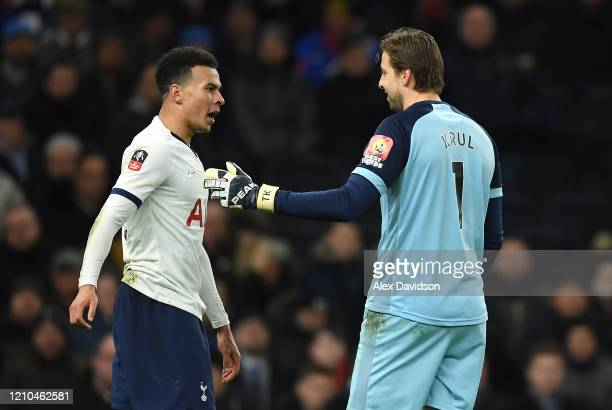 Dele Alli of Tottenham Hotspur confront Tim Krul of Norwich City during the FA Cup Fifth Round match between Tottenham Hotspur and Norwich City at...