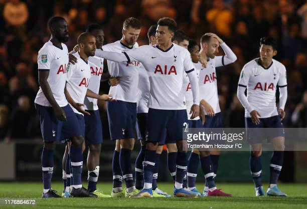 Dele Alli of Tottenham Hotspur consoles Lucas Moura after he misses his penalty in the shootout during the Carabao Cup Third Round match between...